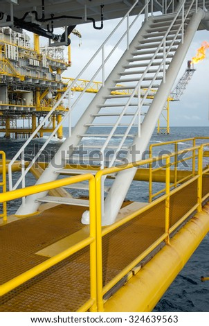 Oil and gas platform in the gulf or the sea. - stock photo