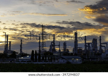 Oil and gas refinery at sunrise - Petrochemical factory - stock photo