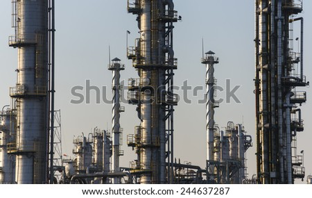 Oil and gas refinery at twilight - Petrochemical factory - stock photo