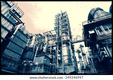oil and gas refinery industry, pipelines and towers - stock photo