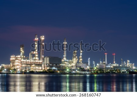 oil and gas refinery petrochemical factory at night - stock photo