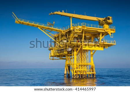 Oil and gas wellhead remote platform produced raw gas and oil then sent to central processing platform to separate water,gas and condensate ( Crude oil )  then sent to onshore and tanker  - stock photo