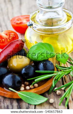 Oil and herbs - stock photo
