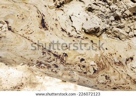Oil and Sand, Oil Spill on Beach - stock photo
