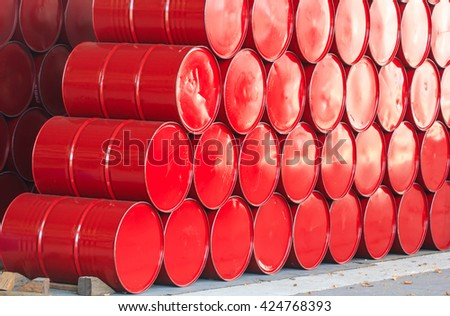 oil barrels or chemical drums stacked up - stock photo