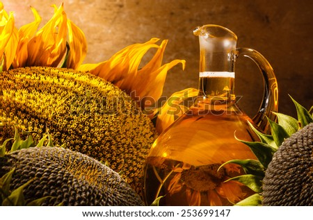 Oil bottle and sunflowers still life - stock photo