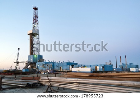 Oil derrick and drilling pipes - stock photo