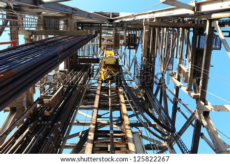 Oil Drilling Derrick with Top Drive, Drill Pipe, Kelly Hose For Oil and Gas Exploration - stock photo
