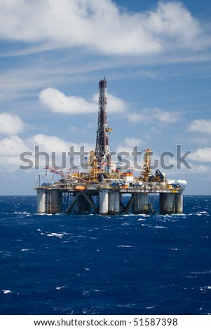 oil drilling rig in offshore area - stock photo