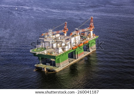 Oil drilling rig on the ocean - stock photo