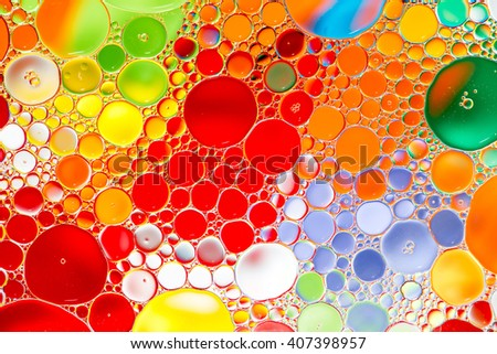 Oil drops in water on a colored background - stock photo