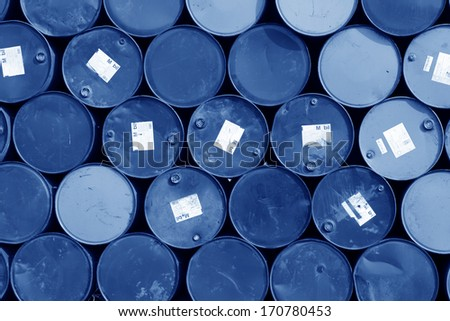 oil drums stacked together in a yard, north china - stock photo