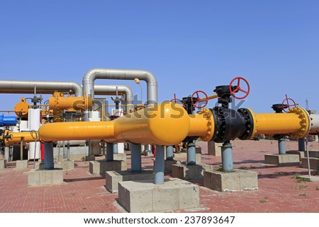 Oil field scene, oilfield equipment at work - stock photo