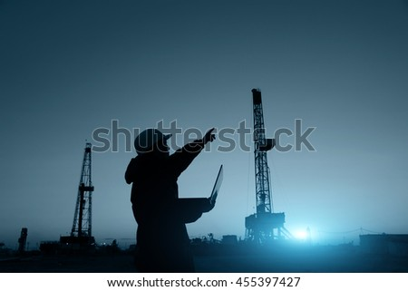 oil field, the oil worker is working - stock photo