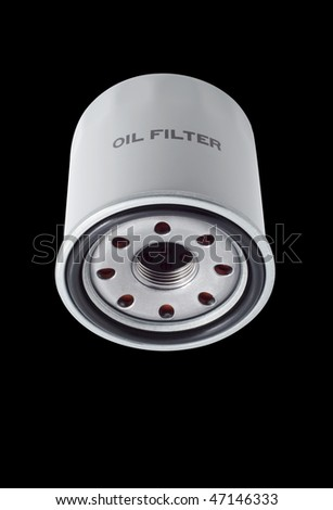 Oil filters for passenger car, isolated, black background - stock photo