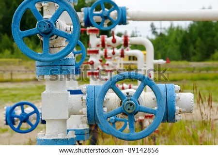 Oil, gas industry. Wellhead with valve armature. - stock photo