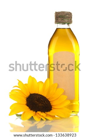 oil in bottle and sunflower, isolated on white - stock photo