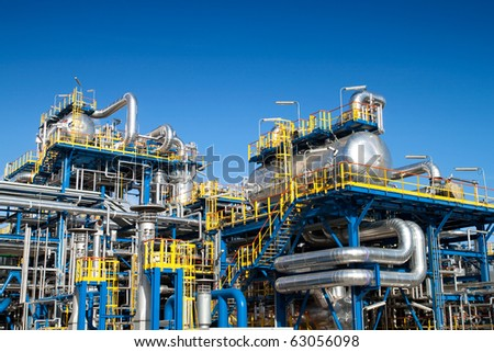 Oil industry equipment installation, metal pipes and constructions. - stock photo