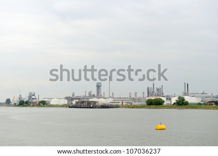 oil industry in the harbor of rotterdam netherlands. oil refinery - stock photo