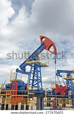 Oil industry. Oil pump jack in work.  - stock photo