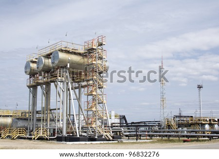 Oil industry scene. Oil and gas refinery plant. Water reservoir - stock photo