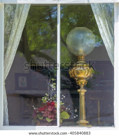 oil lamp in a window - stock photo