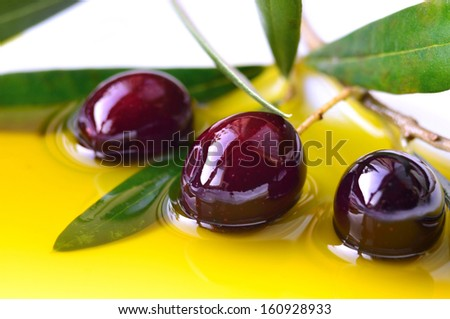 Oil olive and olives.Concept of healthy mediterranean diet.Fresh pressed extra virgin olive oil.Food background. - stock photo