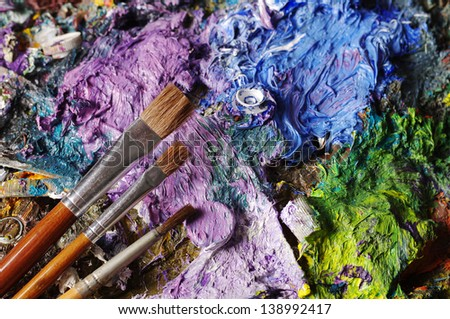 Oil-paint palette and brushes - stock photo