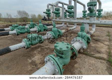 oil pipes in row outdoor - stock photo