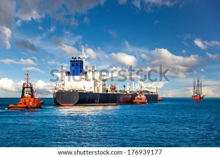 Oil Platform and Tanker in the Sea. - stock photo
