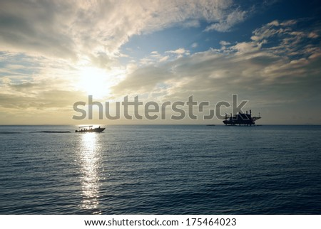 Oil platform in the sea at sunset. - stock photo