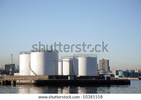 Oil product storage tanks in Aberdeen harbour - stock photo