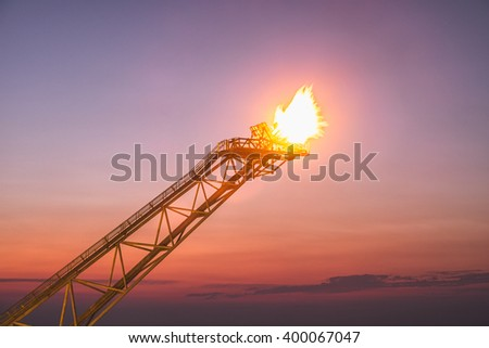 Oil production flare - stock photo