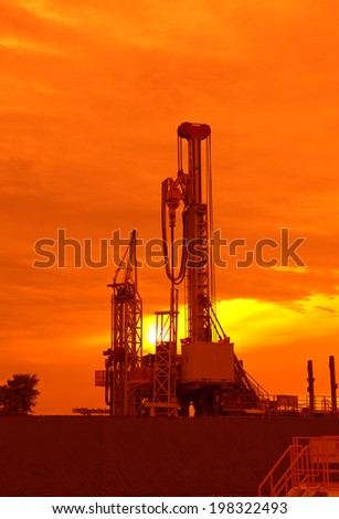 Oil production into the sea from above. - stock photo