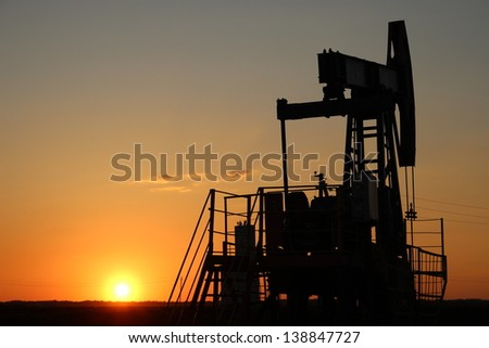 Oil production. Oil pumps at sunset - stock photo