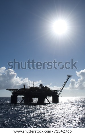 Oil production platform silhouette - stock photo