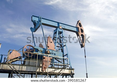 Oil pump and blue sky - stock photo