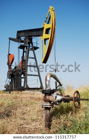 Oil pump and close-up of pipe to trasport the petrol - stock photo