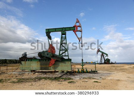 Oil pump in Cuba - stock photo
