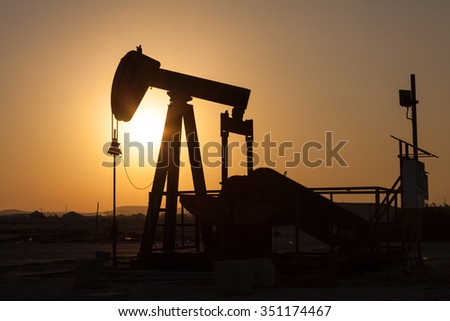 Oil pump in the desert of Bahrain, Middle East - stock photo