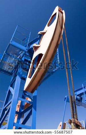 Oil pump jack in work - stock photo