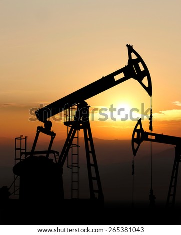oil pump jack working - stock photo