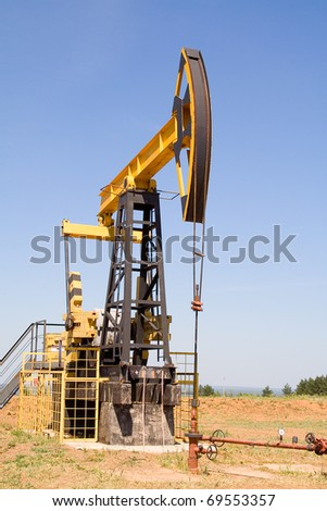 oil pump jacks working at dawn. A pumpjack on the plains - stock photo
