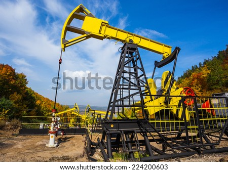 Oil Pump on a background of forest in Russia - stock photo