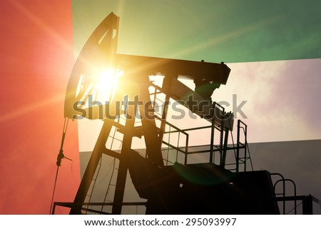 Oil pump on background of flag of Emirates - stock photo