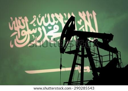 Oil pump on background of flag of Saudi Arabia - stock photo