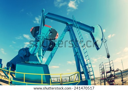 Oil Pump. Tinted in a retro style. - stock photo