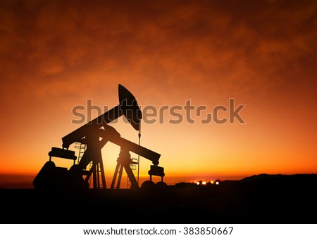 Oil pumps producing oil at dusk. 3D Illustration - stock photo