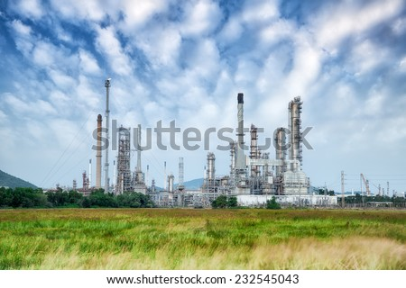 Oil refinery along daytime with blue sky - stock photo