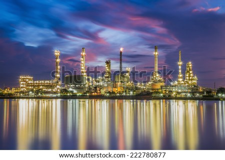 Oil refinery along the river at Dusk (Bangkok, Thailand) - stock photo